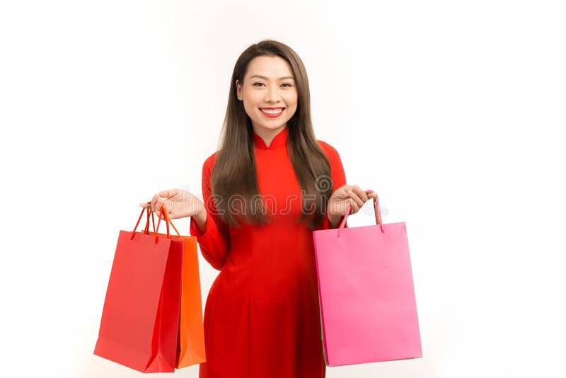 Asian girl in vietnamese ao dai dress with shopping bag isolated on white background.  stock images