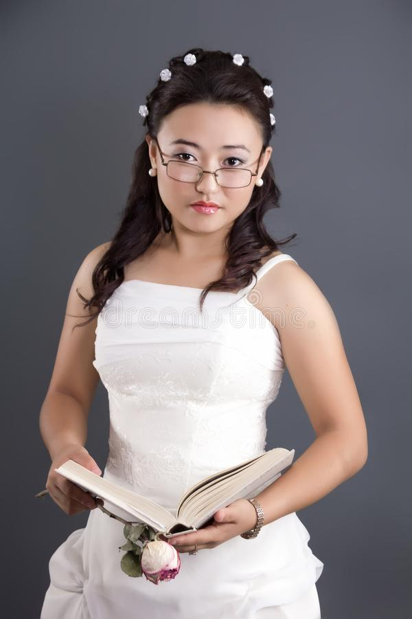 Kazakh young woman with a book in her hands royalty free stock image