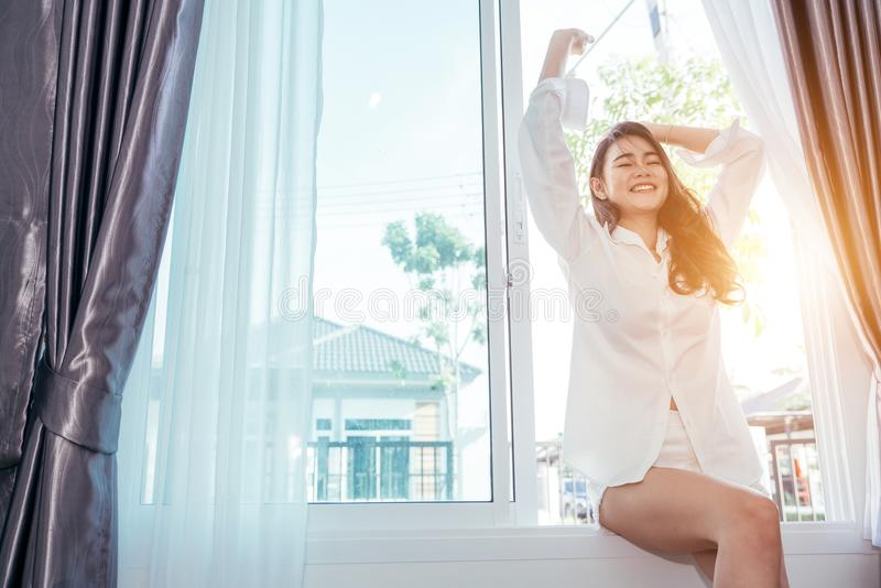 Asian girl who just wake up in the morning stock photos