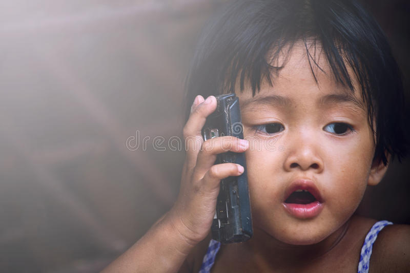 Asian girl who talks on the telephone. At thailand royalty free stock photo