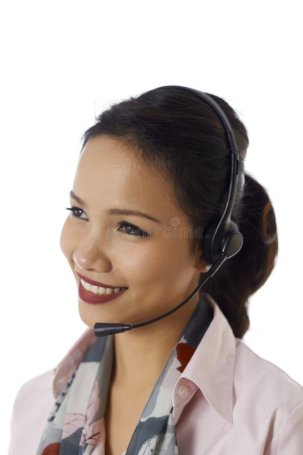 Asian girl working as customer service representative stock images