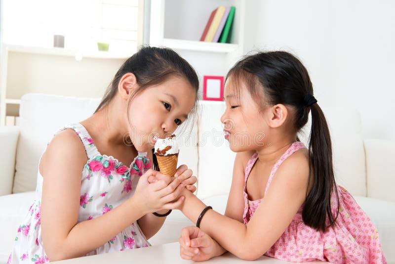 Asian girls eating ice cream stock photography