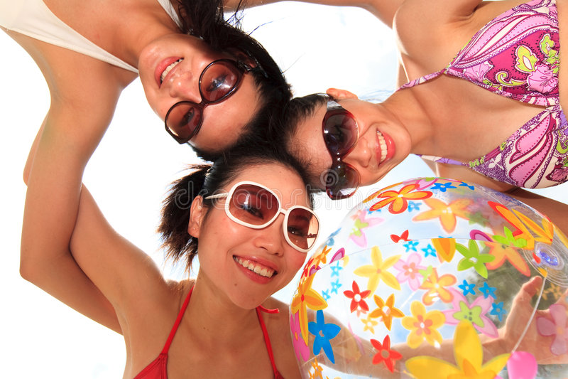 Asian girls have fun under the sun stock image