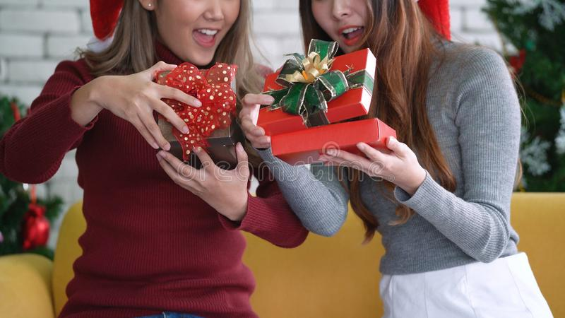 Asian girls open gift box with excited and happy face in Christmas morning stock photo