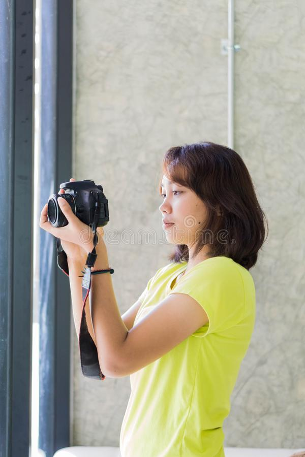 Asian girls use digital cameras stock images