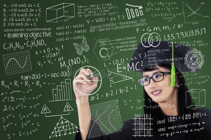 Download Asian Graduate Writing On Board In Class Stock Photo - Image: 31316284