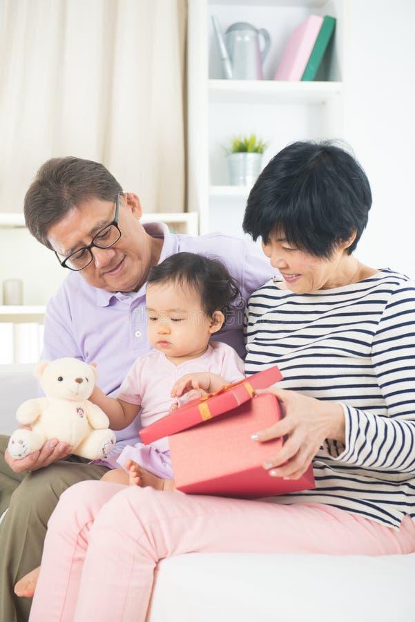 Asian grand parents with grand daugther stock photos
