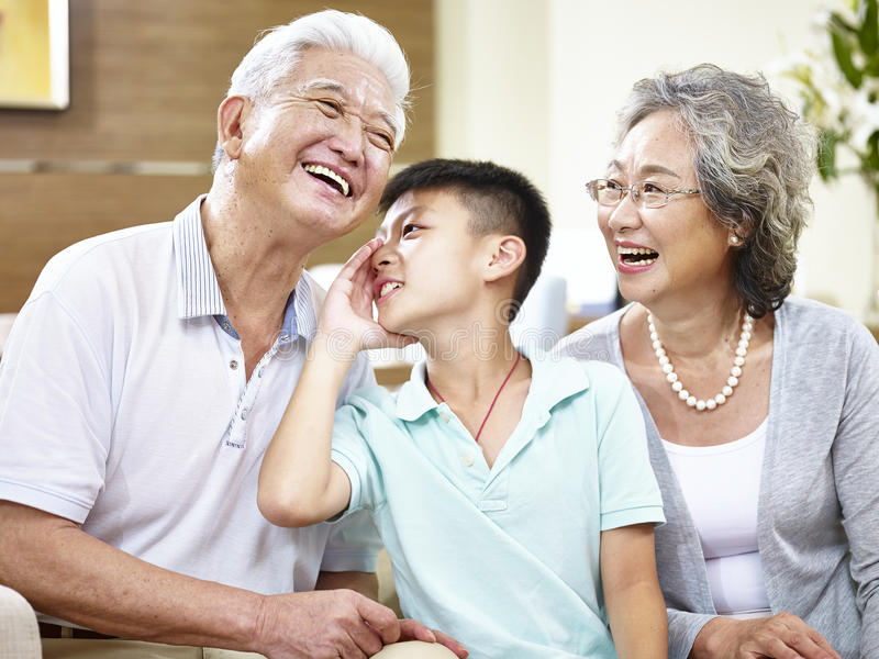 Asian grand parents and grandchild having fun stock photo