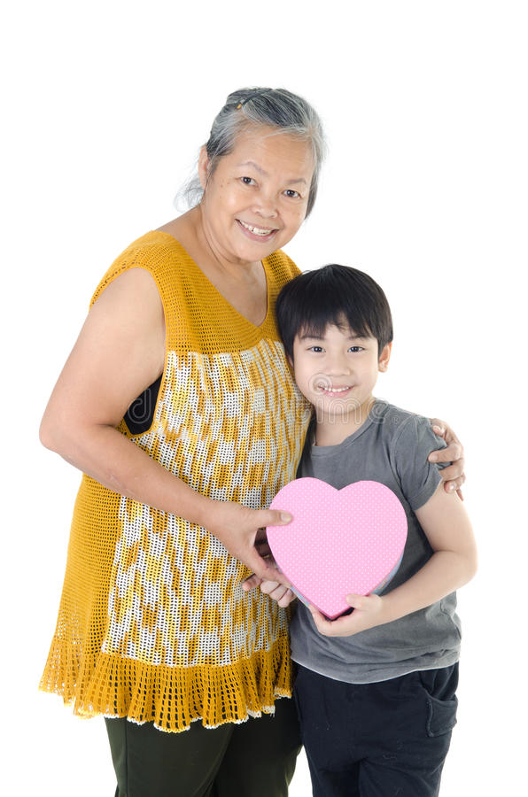 Asian Grandmother and child. With Heart giftbox on white background royalty free stock image