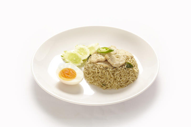 Asian green curry fried rice. On white background stock photo
