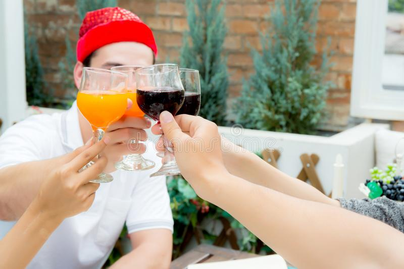 Asian group people drinking at party outdoor. group of friends c. Ocktails in hand with glasses.close up on hand holding beverage stock photos