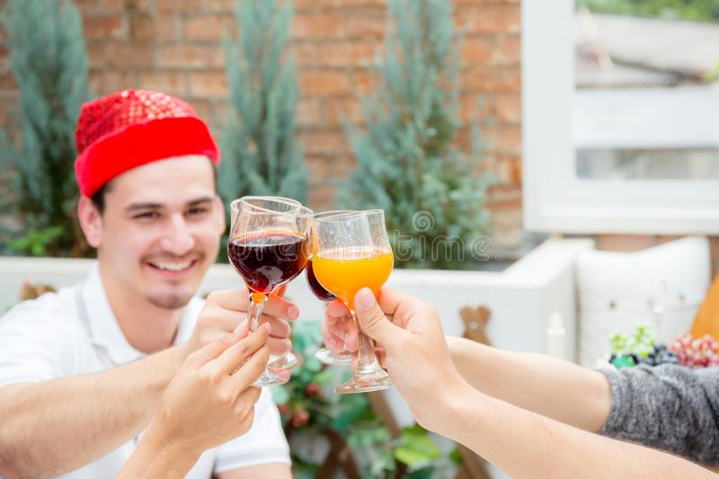 Asian group people drinking at party outdoor. group of friends cocktails in hand with glasses.close up. The asian group people drinking at party outdoor. group royalty free stock image