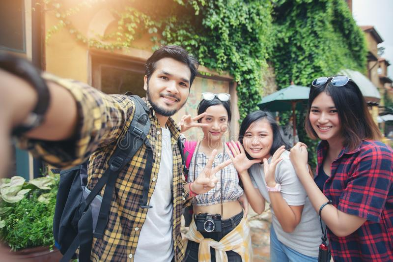 Asian Group of young people with friends backpacks walking together and happy friends are taking photo and selfie ,Relax time on royalty free stock photos