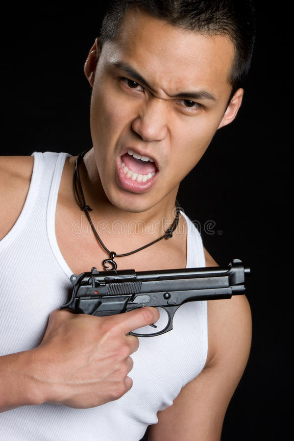 Asian Gun Man stock photo