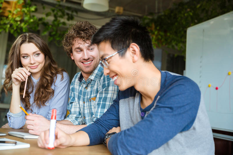 Asian guy feels embarrassed and shy with his friends stock photography