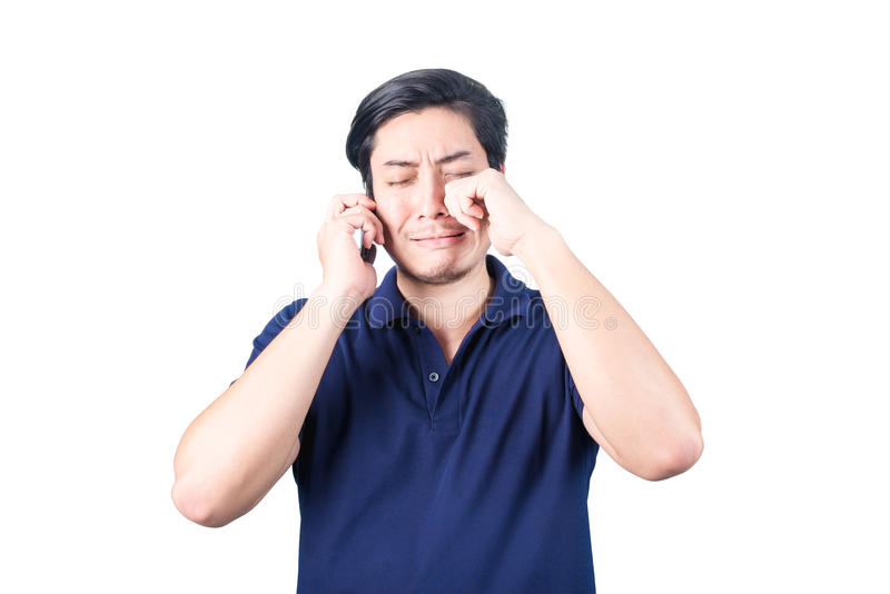 Asian guy with mobile phone in hand and crying, isolated on whit stock images