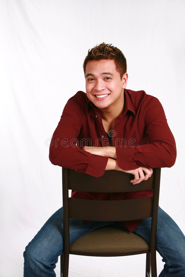 Asian guy seated stock photo