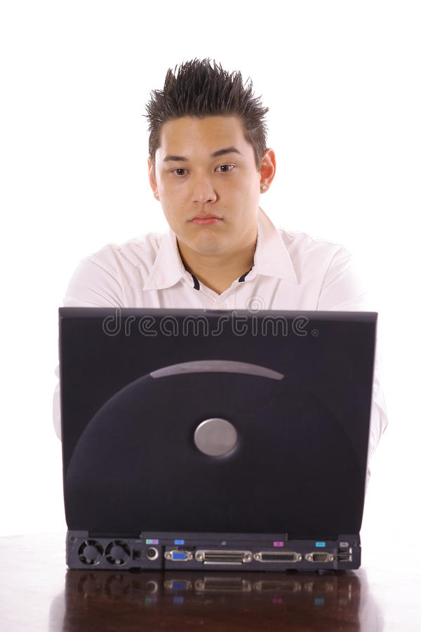 Asian guy sending an email. Shot of an asian guy sending an email stock image