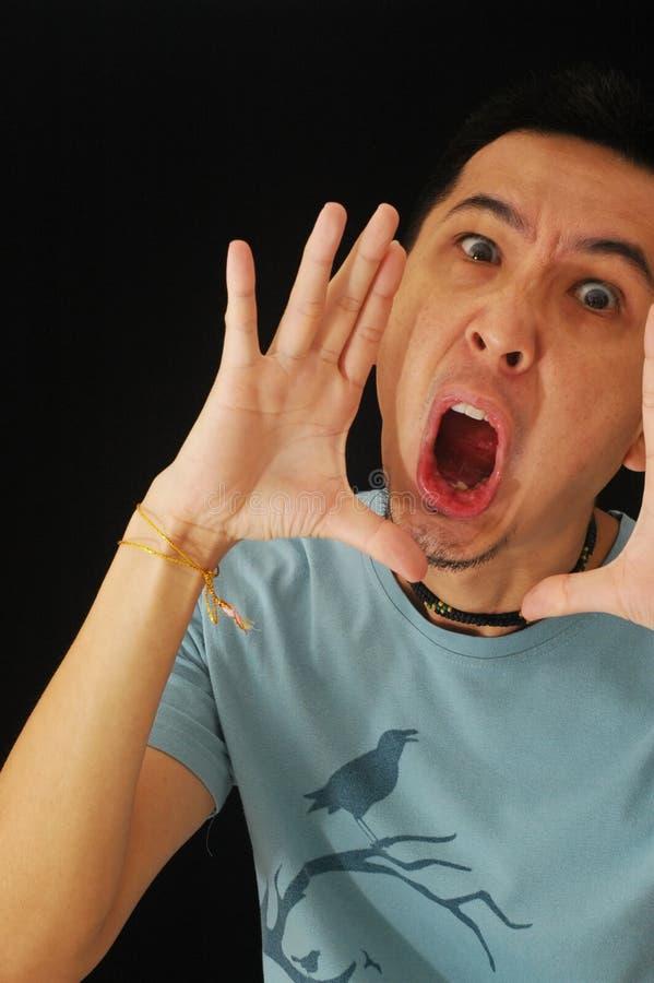 Asian Guy Shouting Royalty Free Stock Photo