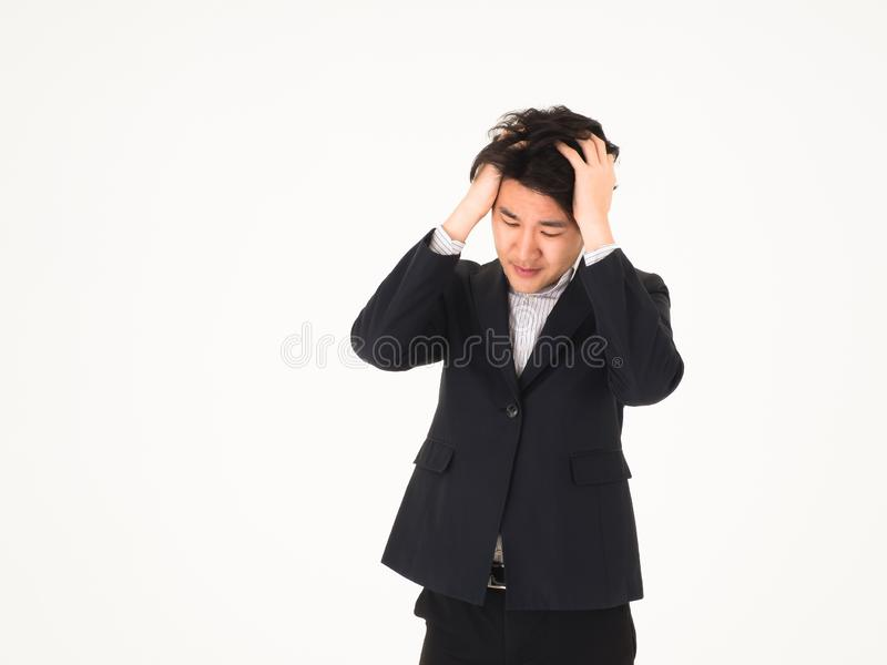 Asian handsome business man catch head because no idea, no solution. Isolated for foreground or background royalty free stock photo