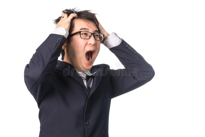 Asian handsome businessman holding his head frowning with worry. stock photos