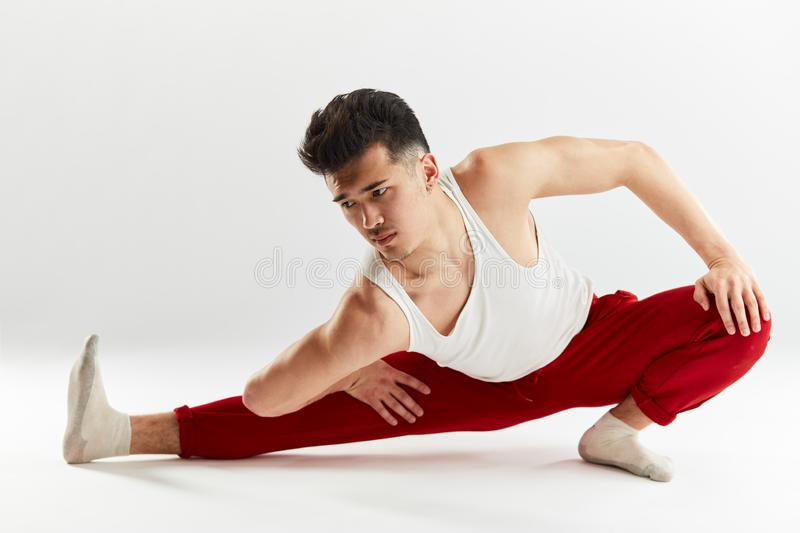 Asian handsome dancer stretching his legs before bboying. royalty free stock images