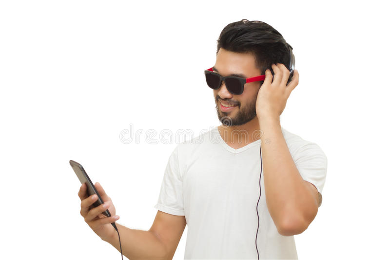 Asian handsome man with a mustache, smiling and laughing and using smart phone to listen music with headphones ,Blurry and soft f stock photos