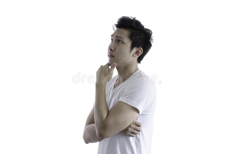 Asian handsome man with white shirt has seriuosly thinking for n stock image