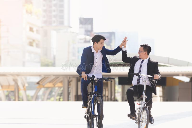 Businessmen riding bicycles stock photography