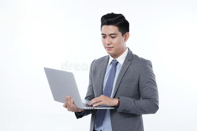 Asian Handsome Young Business Man Isolated on White Background royalty free stock photography