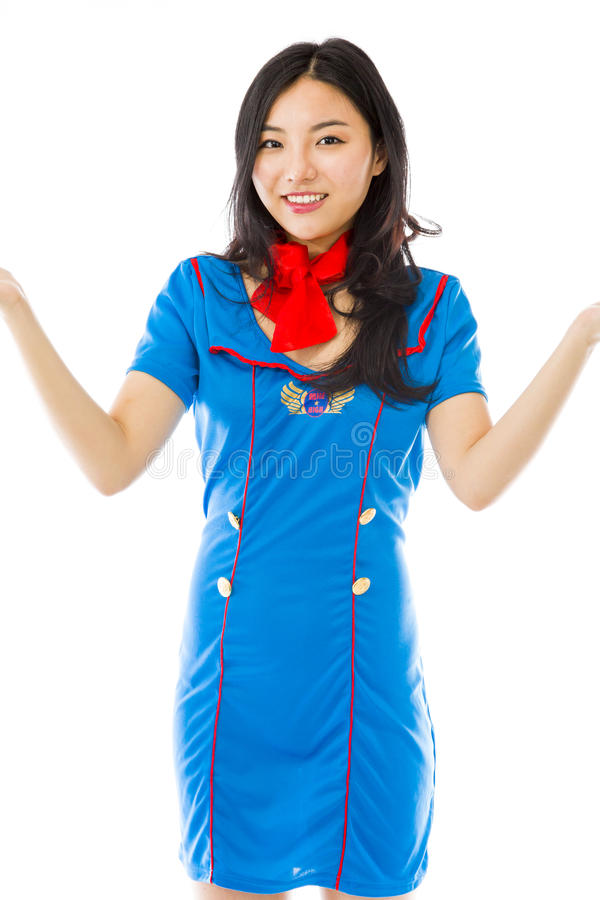 Asian happy air stewardess presenting isolated on white background. Young attractive Asian woman in her 20's shot in studio isolated on a white background royalty free stock image