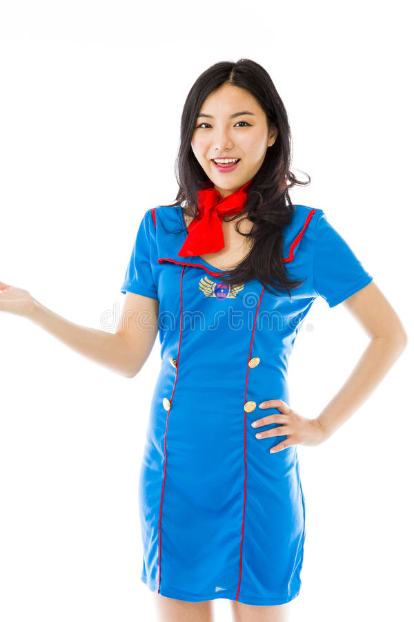 Asian happy air stewardess presenting isolated on white background. Young attractive Asian woman in her 20's shot in studio isolated on a white background stock images