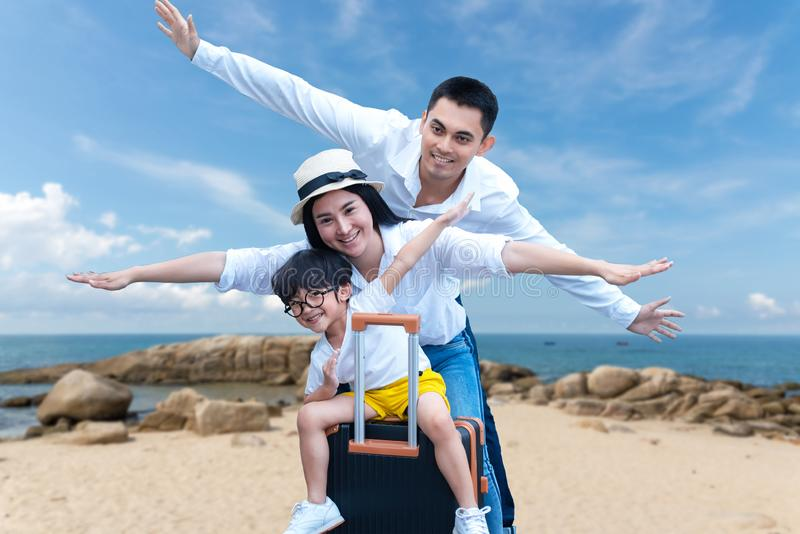 Asian happy family have fun on the beach.  Traveling backpack for travel in vocations for leisure and destination. Family tourism travel in summer and holiday stock photos