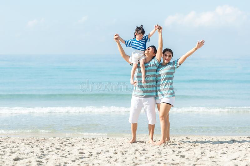Asian happy family have fun fly on the beach for leisure and destination.  Family people tourism travel enjoy in summer and holida stock image