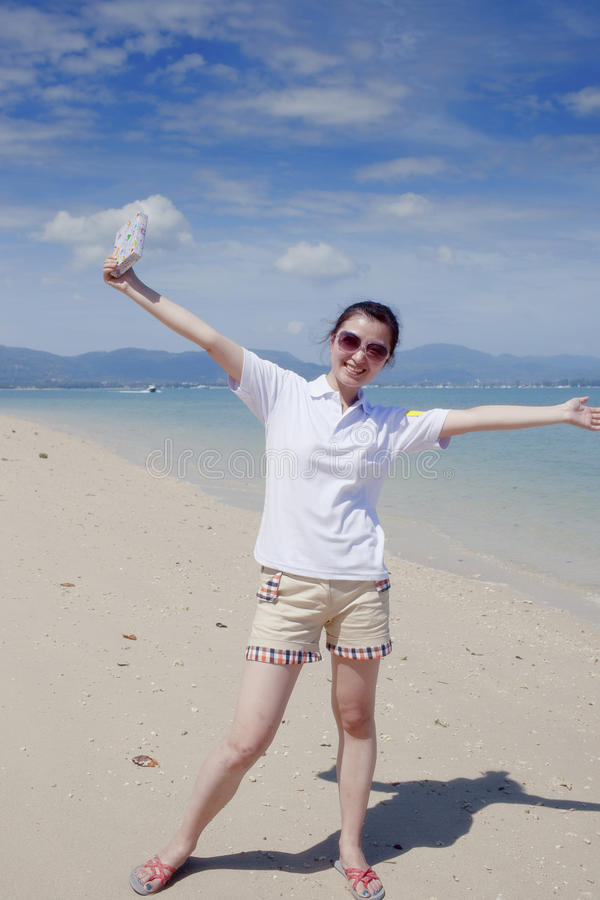 Download Asian Happy Girl Holding The Gift Box On The Beach Stock Image - Image: 22623067