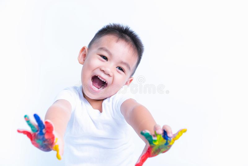 Asian happy little baby boy show hand he have water color or finger paint on hands royalty free stock photo