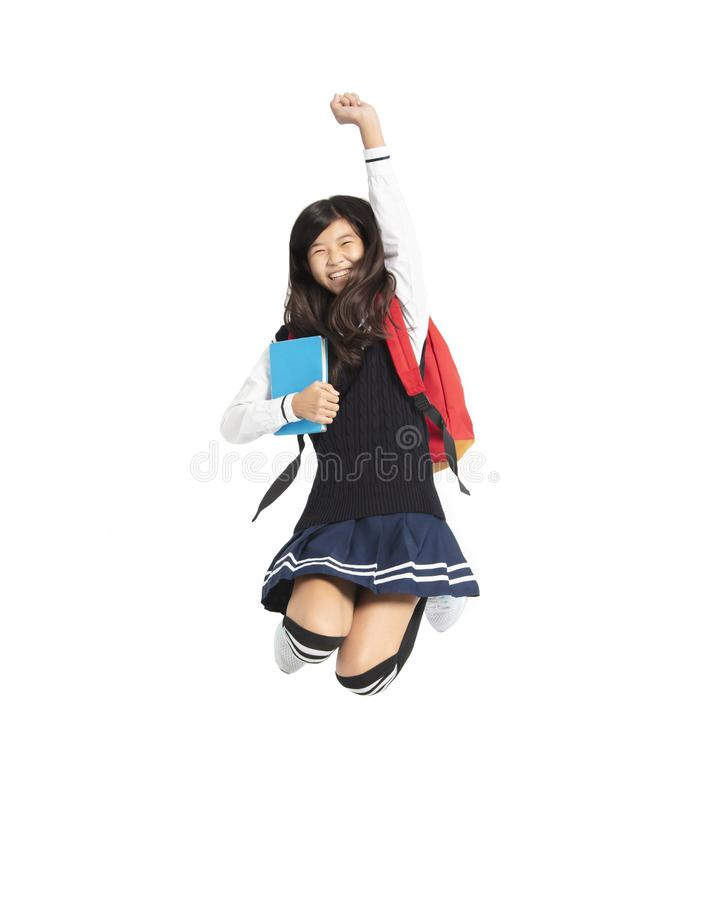 Happy teenager student girl jumping. Asian happy teenager student girl jumping royalty free stock images