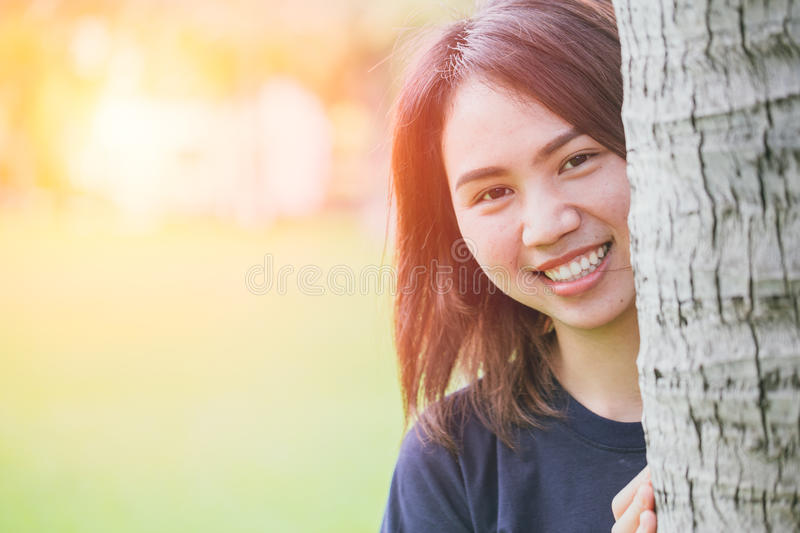 Asian healthy cute teen smile in the park stock images