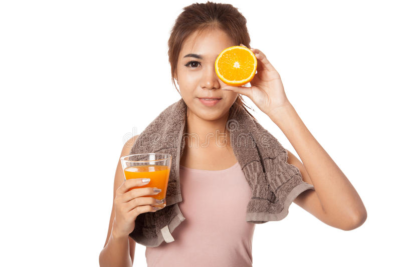 Asian healthy girl with orange juice and orange over her eye royalty free stock images