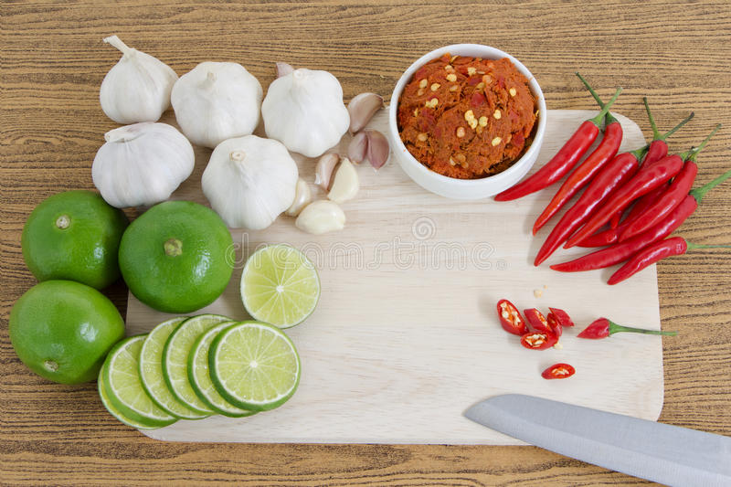 Asian herb and spicy with Chillli, garlic, lime and curry paste. On wooden Chopping board royalty free stock photography