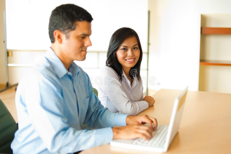 Asian And Hispanic Business Meeting royalty free stock image