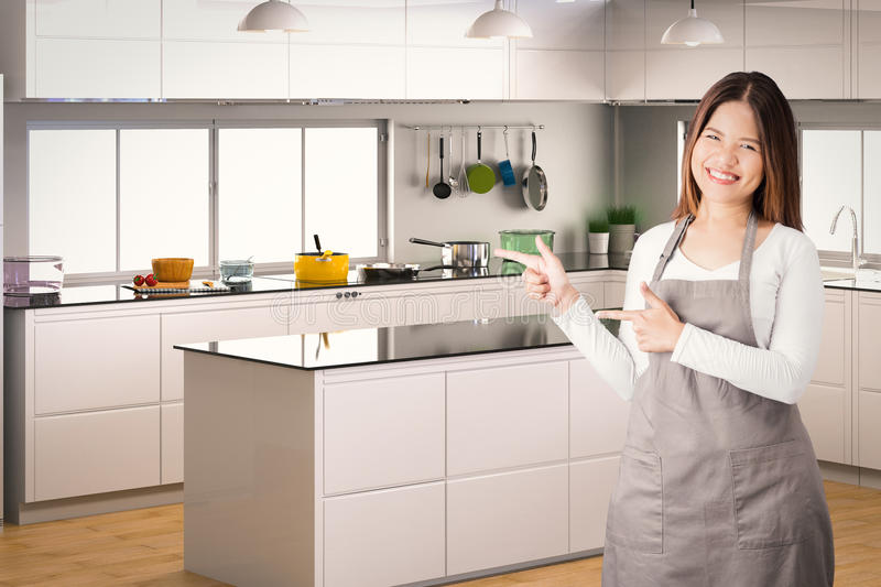 Asian housekeeper. With kitchen background royalty free stock photography