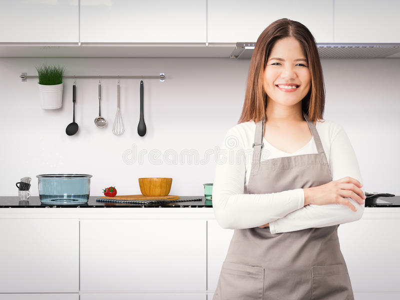Asian housekeeper. With kitchen background stock image