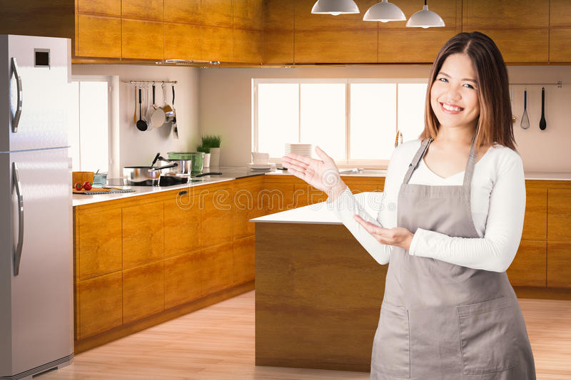 Asian housekeeper. With kitchen background royalty free stock image