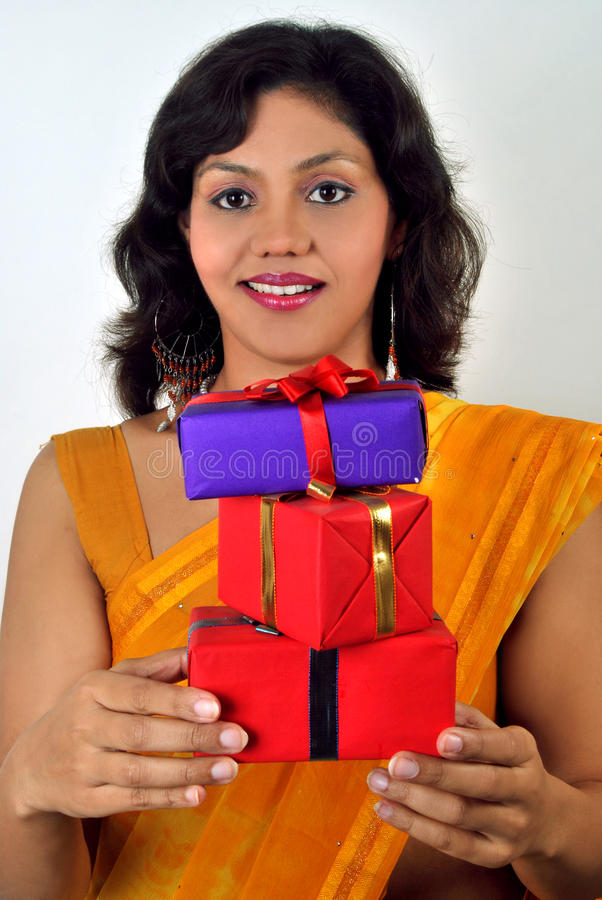 Asian Indian woman with gifts royalty free stock photo