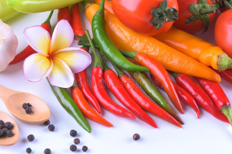 Asian ingredients food fresh spices Vegetable tomato, chilli, garlic, pepper, plumeria close up royalty free stock image