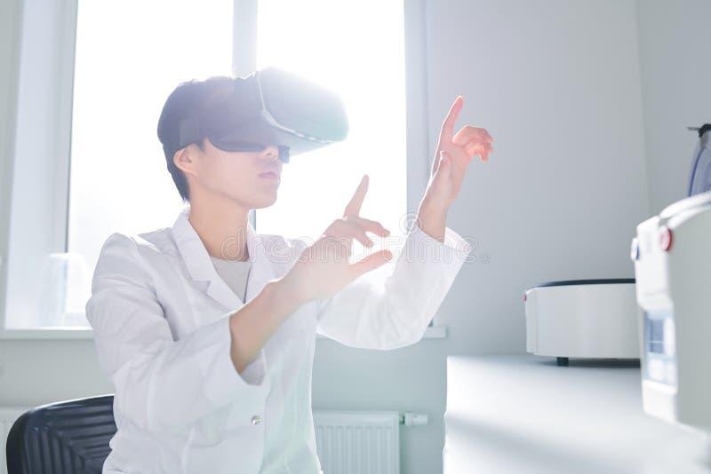 Asian innovation scientist using VR simulator stock photos
