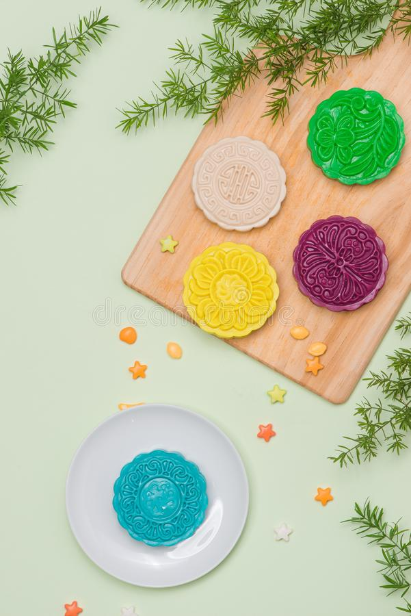 Asian, Japanian food, Traditional sweet dessert multicolored no. Bake snow skin mooncakes on white marble table. copy space top view stock photography