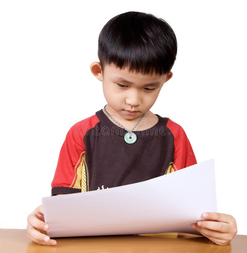 Asian kid. With his bad exam result royalty free stock image