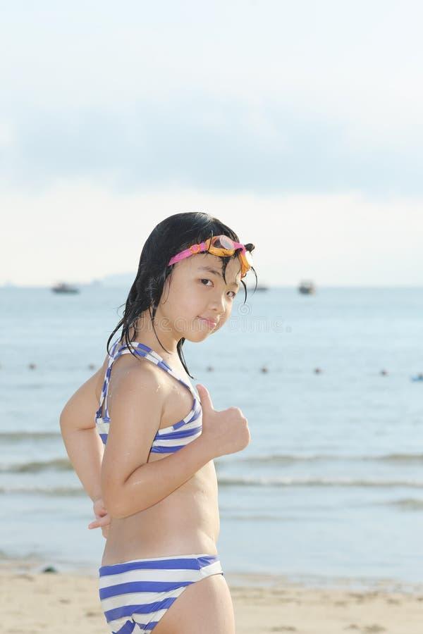 Asian kid on beach stock photo